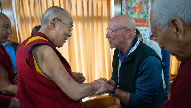 His Holiness the Dalai Lama greeting old friends as he arrives for the first session of the Mind and Life Conversation at his residence in Dharamsala, HP, India on October 30, 2019. Photo by Tenzin Choejor