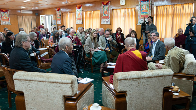Pariticipants engaging in discsussion after a tea break on the first day of the Mind and Life Conversation with His Holiness the Dalai Lama at his residence in Dharamsala, HP, India on October 30, 2019. Photo by Tenzin Choejor