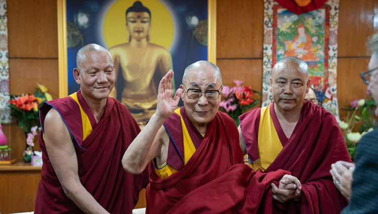 His Holiness the Dalai Lama waving to participants as he prepares to leave the meeting room at the conclusion of the first day of the Mind and Life Conversation at his residence in Dharamsala, HP, India on October 30, 2019. Photo by Tenzin Choejor