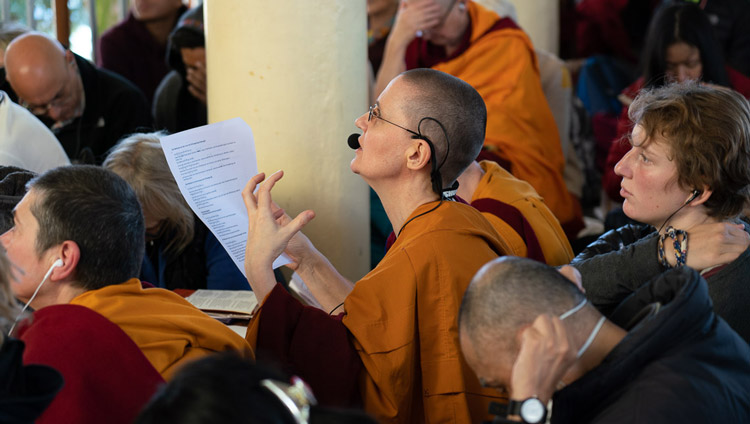 The German language interpreter, one of twelve languages being translated, working during the second day of His Holiness the Dalai Lama's teaching at the Main Tibetan Temple in Dharamsala, HP, India on November 5, 2019. Photo by Ven Tenzin Jamphel
