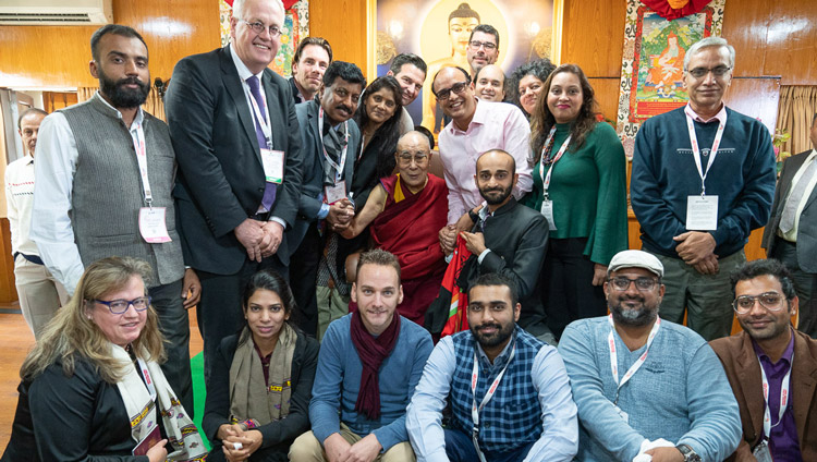 His Holiness the Dalai Lama posing for a group photo with delegates to the Rising Himachal Global Investors' Meet after their meeting at his residence in Dharamsala, HP, India on November 8, 2019. Photo by Tenzin Choejor