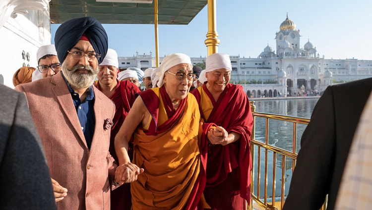 His Holiness the Dalai Lama walking down the causeway to the Dabar Shahib at the Golden Temple in Amritsar, Punjab, India on November 9, 2019. Photo by Tenzin Choejor