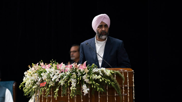 Government of Punjab Finance Minister Manpreet Singh Badal welcoming the audience and participants at the start of the Inter-Faith Conclave at Guru Nanak Dev University in Amritsar, Punjab, India on November 9, 2019. Photo by Tenzin Choejor
