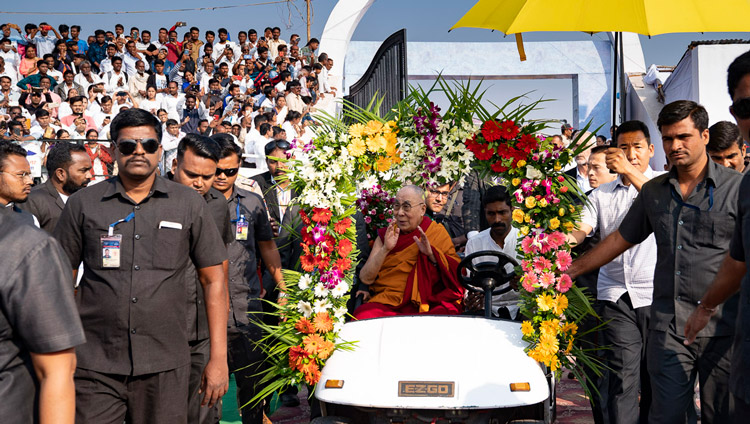 His Holiness the Dalai Lama riding in a golf-cart to the stage at the stadium of PES College of Physical Education in Aurangabad, Maharashtra, India on November 24, 2019. Photo by Tenzin Choejor