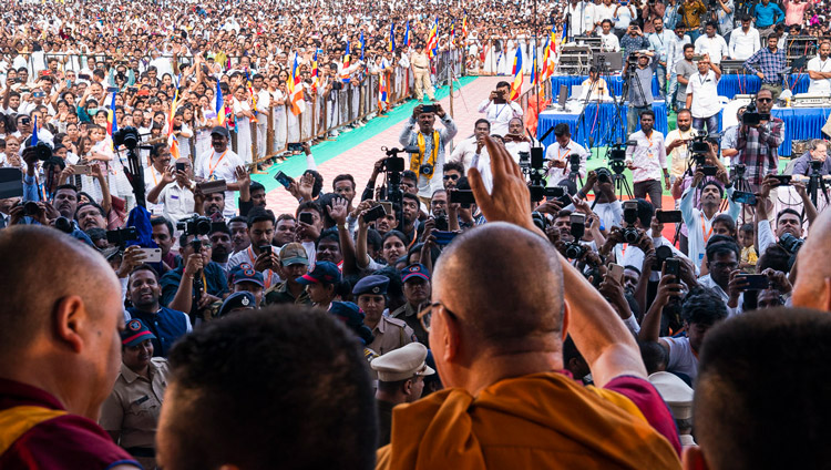 His Holiness the Dalai Lama waving to the crowd as he prepares to leave the stage at the end of his talk at PES College of Physical Education in Aurangabad, Maharashtra, India on November 24, 2019. Photo by Tenzin Choejor