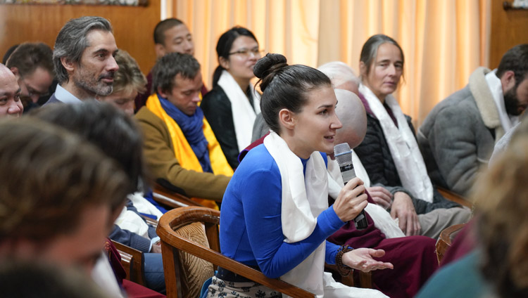 A trainee translator asking His Holiness the Dalai Lama a question during his meeting with Tibetan Studies' students at his residence in Dharamsala, HP, India on December 2, 2019. Photo by Ven Tenzin Jamphel