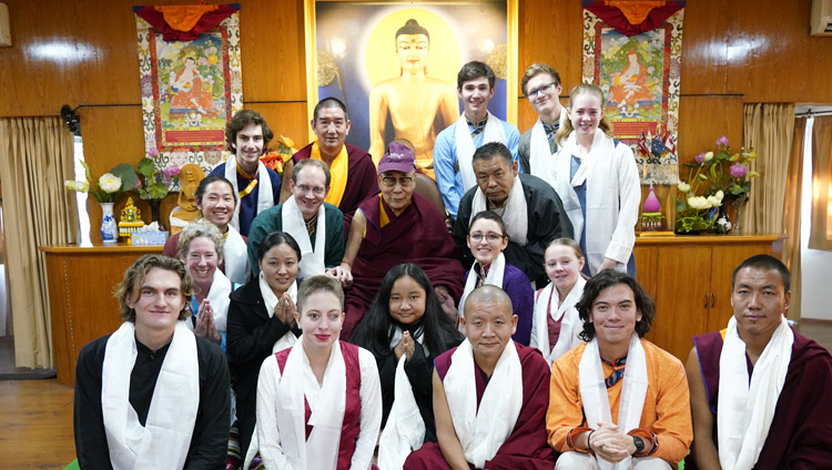 His Holiness the Dalai Lama wearing a cap presented by students from Earlham College during a group photo after their meeting at his residence in Dharamsala, HP, India on December 2, 2019. Photo by Ven Tenzin Jamphel