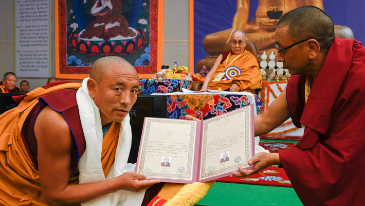 Karma Gelek Yuthok, Kalon for Religion & Culture presenting Certificates of Graduation at the Symposium on Monastic Education to mark the 25th anniversary of Kirti Jepa Dratsang in Dharamsala, HP, India on December 7, 2019. Photo by Manuel Bauer