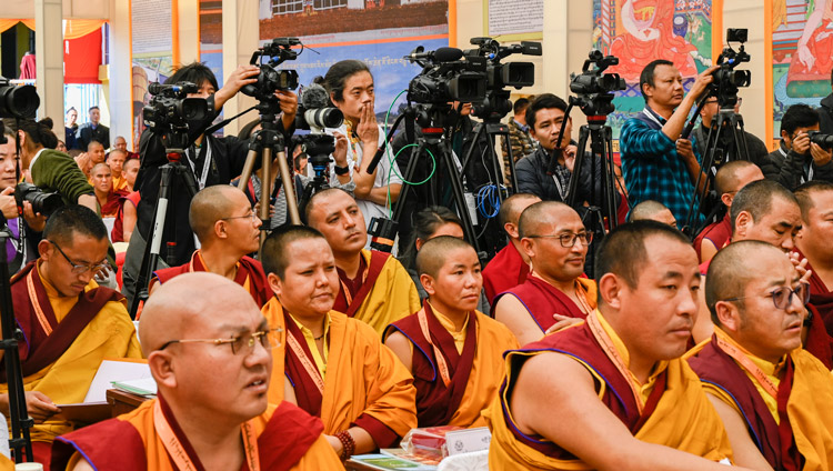A view of members of the press filming His Holiness the Dalai Lama speaking at the inauguration of he Symposium on Monastic Education to mark the 25th anniversary of Kirti Jepa Dratsang in Dharamsala, HP, India on December 7, 2019. Photo by Manuel Bauer