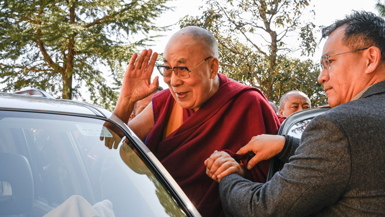 His Holiness the Dalai Lama waving to the crowd as departs for his residence at the conclusion of the inauguration of the Symposium on Monastic Education to mark the 25th anniversary of Kirti Jepa Dratsang in Dharamsala, HP, India on December 7, 2019. Photo by Manuel Bauer