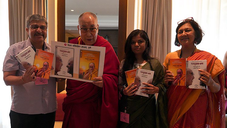 """His Holiness the Dalai Lama releasing a Marathi language translation of his book with Archbishop Desmond Tutu """"Book of Joy"""" in Goa, India on December 11, 2019. Photo by Lobsang Tsering"""