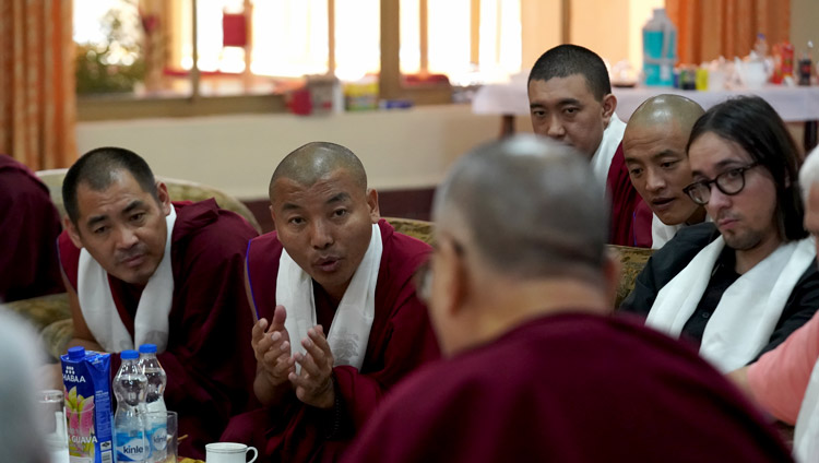 A Tibetan monk who had undergone training in Russia sharing his experiences with His Holiness the Dalai Lama during his discussion with participants in a Russian research program at his residence at Drepung Gomang Monastery in Mundgod, Karnataka, India on December 13, 2019. Photo by Lobsang Tsering