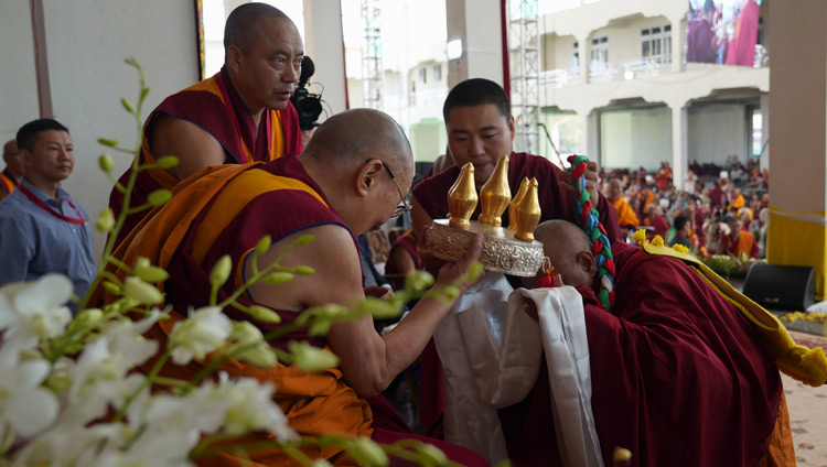 Abbot Lobsang Gyaltsen offering a mandala and the threefold representations of the Buddha's body, speech and mind at the inauguration of Drepung Gomang Monastery's new debate yard in Mundgod, Karnataka, India on December 14, 2019. Photo by Lobsang Tsering
