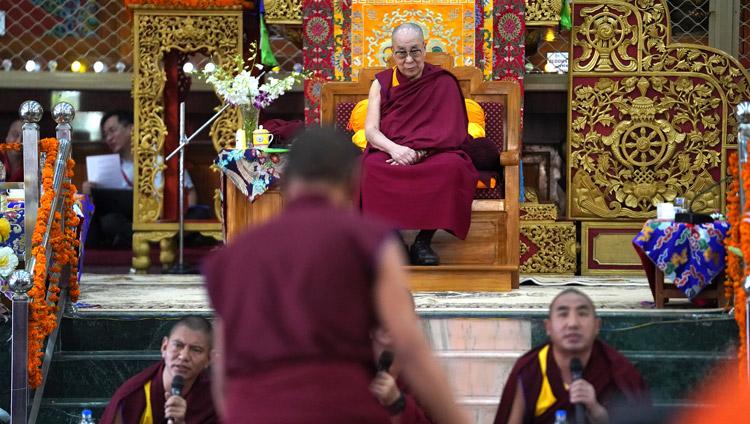 His Holiness the Dalai Lama listening attentively to monks debating Buddhist philosophy at Drepung Gomang Assembly Hall in Mundgod, Karnataka, India on December 15, 2019. Photo by Lobsang Tsering