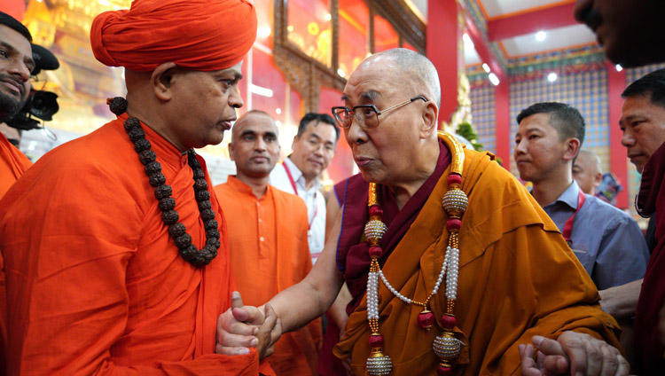 His Holiness the Dalai Lama exchanging a few words with a local Swami who came to meet him at Drepung Loseling Monastery in Mundgod, Karnataka, India on December 15, 2019. Photo by Lobsang Tsering