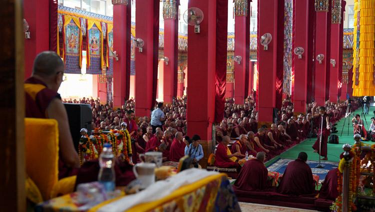 His Holiness the Dalai Lama watching student monks debating Buddhist philosophy at Drepung Loseling Assembly Hall in Mundgod, Karnataka, India on December 18, 2019. Photo by Lobsang Tsering