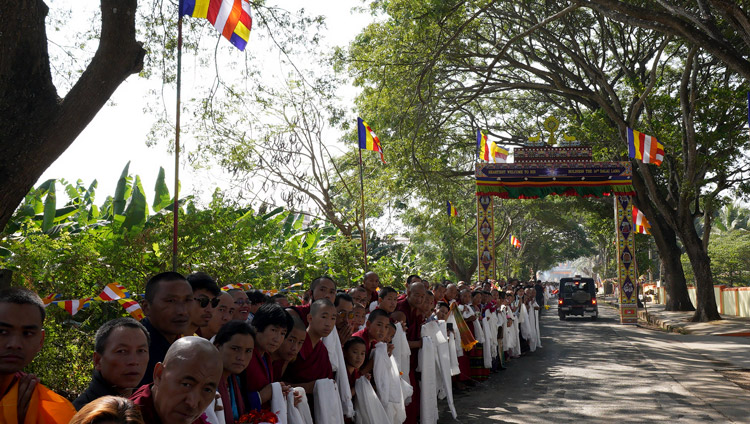 Local people from the surrounding Tibetan settlement lining the road to catch a glimpse of His Holiness the Dalai Lama as he drives from Drepung Monastery to Gaden Monastery in Mundgod, Karnataka, India on December 18, 2019. Photo by Lobsang Tsering