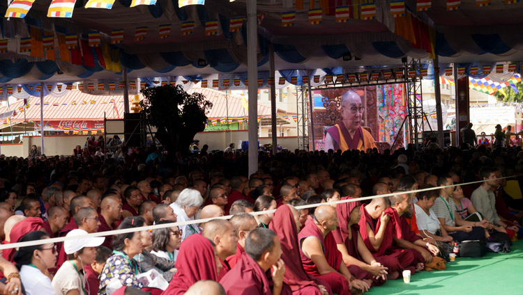 Many of the overflow crowd of 5000 in the courtyard of Gaden Lachi watching His Holiness the Dalai Lama speaking at the International Conference on Je Tsongkhapa at Gaden Lachi in Mundgod, Karnataka, India on December 20, 2019. Photo by Lobsang Tsering