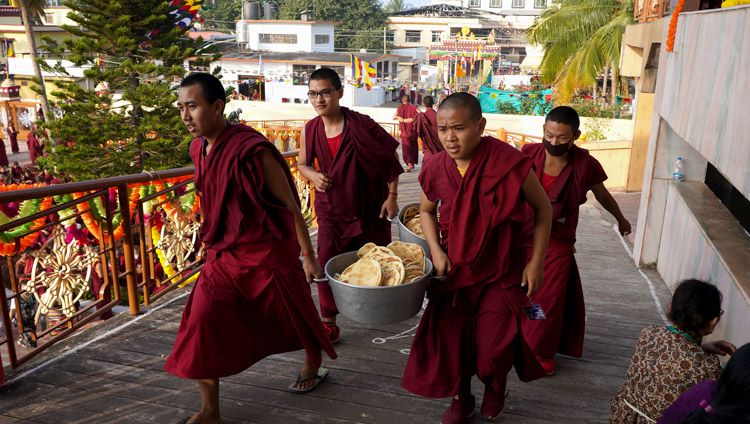 Young monks carry bread to distribute to the over 5,000 people attending the Long Life Offering for His Holiness the Dalai Lama at Gaden Jangtse Monastery in Mundgod, Karnataka, India on December 22, 2019. Photo by Lobsang Tsering