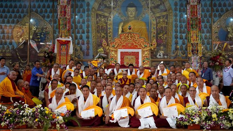 His Holiness the Dalai Lama posing for group photos with newly graduated Geshe Lharamapas at Gaden Jangtse Monastery in Mundgod, Karnataka, India on December 22, 2019. Photo by Lobsang Tsering