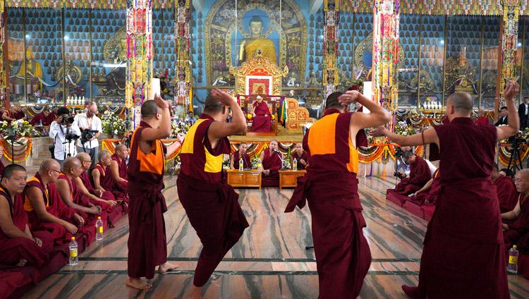 Student monks debating Buddhist philosophy in front of His Holiness the Dalai Lama at the Ganden Jangtsé Assembly Hall in Mundgod, Karnataka, India on December 23, 2019. Photo by Lobsang Tsering