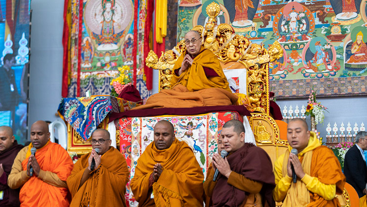 Monks from Sri Lanka and India reciting a section of the 'Mangala Sutta' in Pali at the start of His Holiness the Dalai Lama's teaching at the Kalachakra Ground in Bodhgaya, Bihar, India on January 2, 2020. Photo by Tenzin Choejor