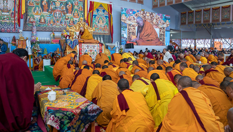 Geshes filling the stage in front of His Holiness the Dalai Lama to get protection from the rain at the Kalachakra Ground in Bodhgaya, Bihar, India on January 3, 2020. Photo by Tenzin Choejor