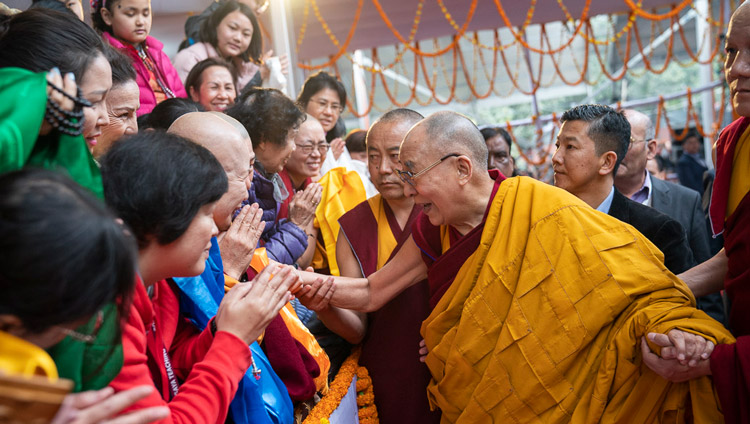 His Holiness the Dalai Lama greeting members of the crowd as he arrives at the Kalachakra Ground in Bodhgaya, Bihar, India on January 5, 2020. Photo by Tenzin Choejor