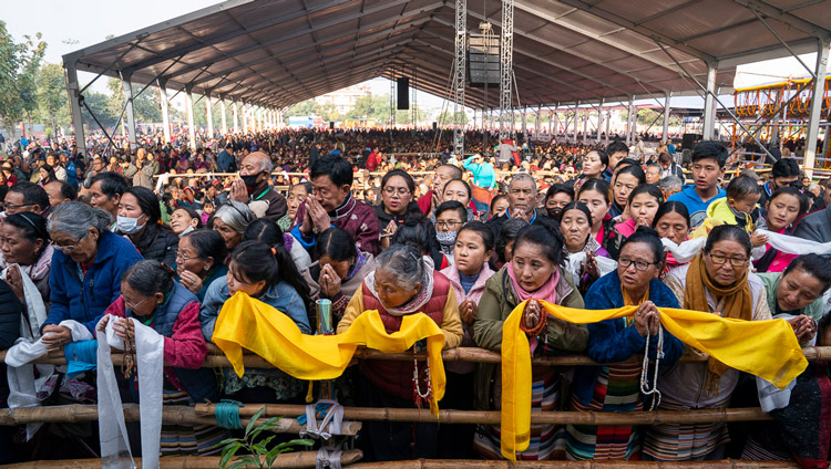 Members of the crowd waiting for His Holiness the Dalai Lama's arrival at the Kalackakra Ground in Bodhgaya, Bihar, India on January 6, 2020. Photo by Tenzin Choejor