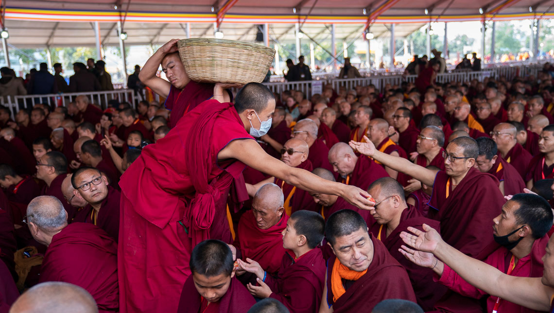 Volunteers distributing longevity pills on the final day His Holiness the Dalai Lama's teachings at the Kalachakra Teaching Ground in Bodhgaya, Bihar, India on January 6, 2020. Photo by Tenzin Choejor