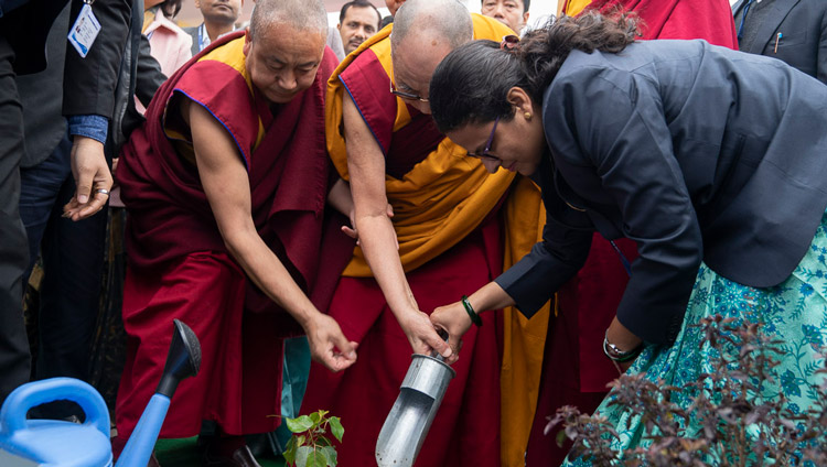 His Holiness the Dalai Lama planting a sapling to commemorate his visit to the Indian Institute of Management (IIM) on the campus of Magadh University in Bodhgaya, Bihar, India on January 14, 2020. Photo by Lobsang Tsering