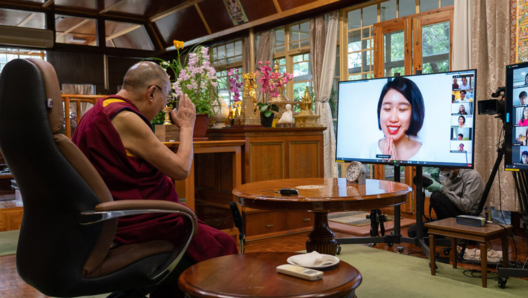 His Holiness the Dalai Lama greeting one of the participants before she asks her question during his dialogue by video conference with young people from South-east Asia from his residence in Dharamsala, HP, India on June 7, 2020. Photo by Ven Tenzin Jamphel