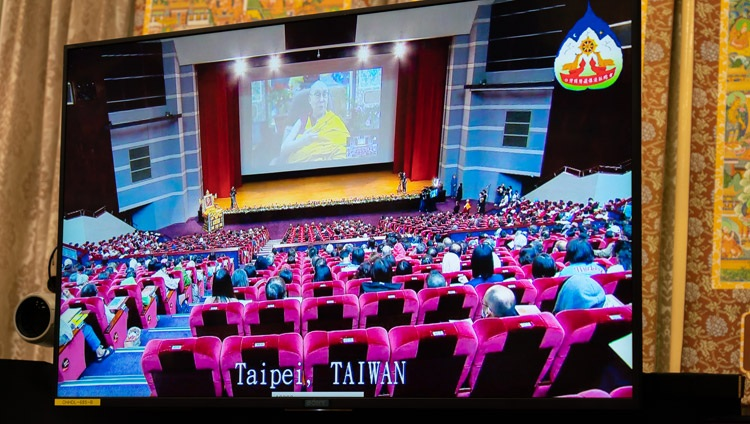 A view of the hall in Taipei shown on one of the TV screens in front of His Holiness the Dalai Lama during the first day of teachings from his residence in Dharamsala, HP, India on October 2, 2020. Photo by Ven Tenzin Jamphel
