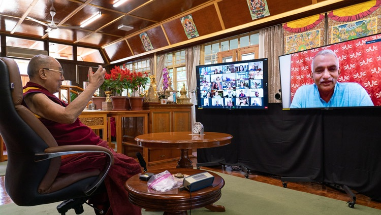 """His Holiness the Dalai Lama answering a question posed by social worker, and son of Baba Amte, Prakash Baba Amte, during his talk virtual talk on """"India's Heritage of Karuna and Ahimsa"""" from his residence in Dharamsala, HP, India on October 26, 2020. Photo by Ven Tenzin Jamphel"""