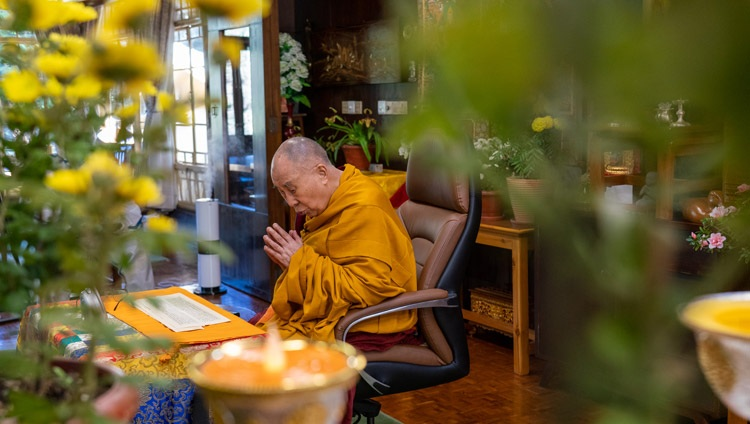 "His Holiness the Dalai Lama reading from Nagarjuna's ""Commentary on the Awakening Mind"" on the second day of his virtual teachings from his residence in Dharamsala, HP, India on November 6, 2020. Photo by Ven Tenzin Jamphel"