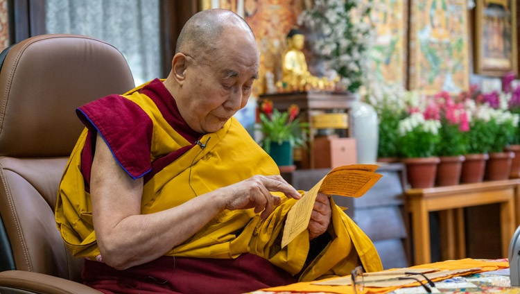 His Holiness the Dalai Lama reading from the texts during his teachings requested by the Tibetan community in North America from his residence in Dharamsala, HP, India on December 27, 2020. Photo by Ven Tenzin Jamphel