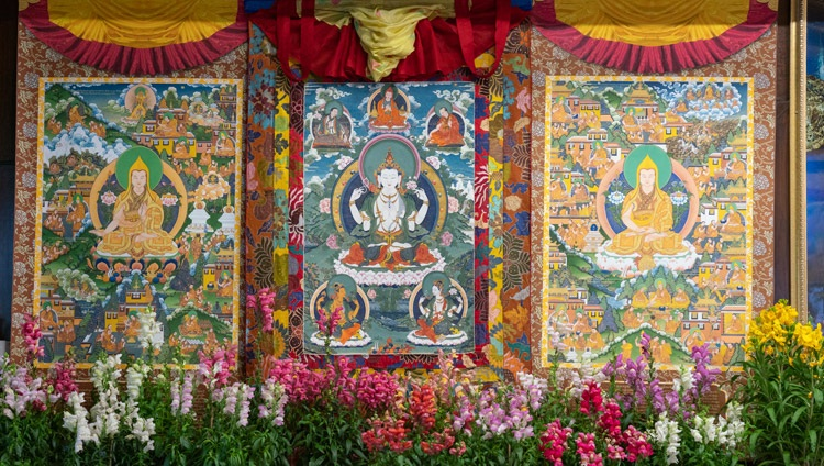 The central figure in these thangka paintings hanging behind His Holiness is the four armed Avalokiteshvara described in the Guru Yoga of Avalokiteshvara, the transmission of which he gave on the final day of his teachings from his residence in Dharamsala, HP, India on January 7, 2021. Photo by Ven Tenzin Jamphel
