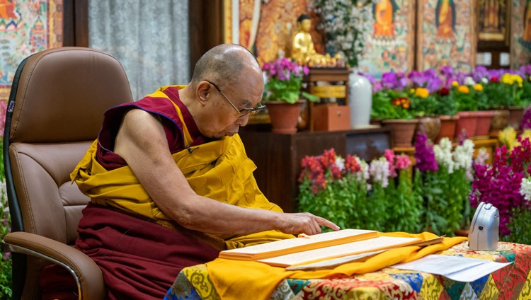 His Holiness the Dalai Lama reading from Nagarjuna's 'Precious Garland' during his teachings on the full-moon day of the Great Prayer Festival online from his residence in Dharamsala, HP, India on February 27, 2021. Photo by Ven Tenzin Jamphel
