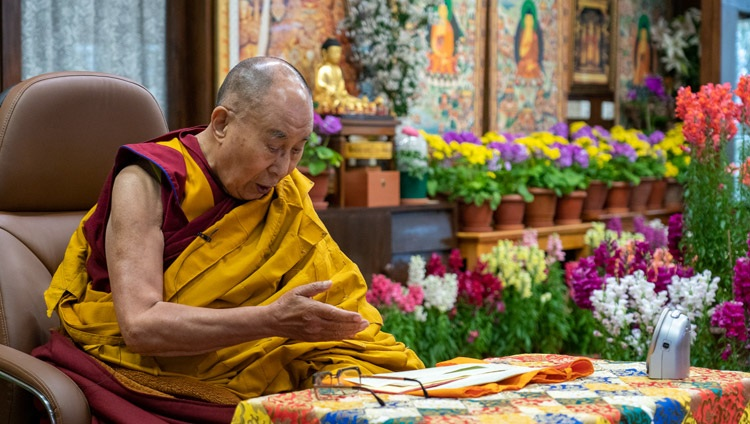 His Holiness the Dalai Lama reading from Praise for Seventeen Nalanda Masters on the first day of his online teachings requested by Mongolians from his residence in Dharamsala, HP, India on March 12, 2021. Photo by Ven Tenzin Jamphel