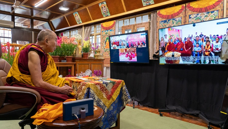 His Holiness the Dalai Lama watching a video about 'Achlalt khuukhduud', an orphanage and nursing home in Mongolia during the first day of online teachings from his residence in Dharamsala, HP, India on March 12, 2021. Photo by Ven Tenzin Jamphel