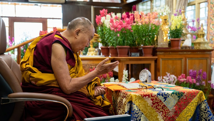 His Holiness the Dalai Lama reading from Tsongkhapa's 'Three Principal Aspects of the Path' during his online teaching from his residence in Dharamsala, HP, India on March 13, 2021. Photo by Ven Tenzin Jamphel