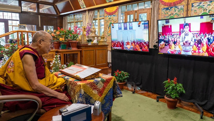 A member of the audience at the Jokhang Temple in Leh, Ladakh, India, asking His Holiness the Dalai Lama a question on the first day of online teachings from his residence in Dharamsala, HP, India on July 13, 2021. Photo by Ven Tenzin Jamphel