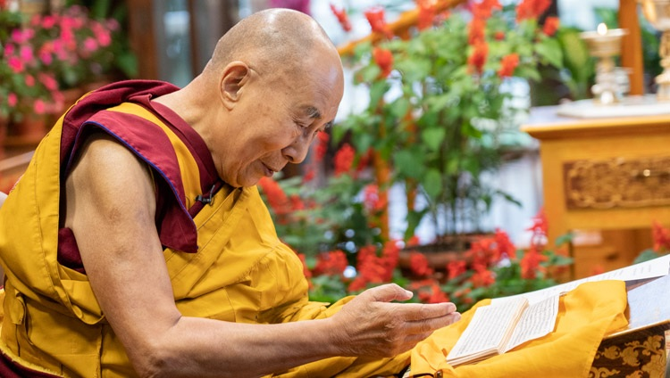 """His Holiness the Dalai Lama reading from Chandrakirti's auto-commentary on """"Entering the Middle Way"""" during his online teachings from his residence in Dharamsala, HP, India on September 8, 2021. Photo by Ven Tenzin Jamphel"""