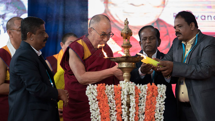 His Holiness the Dalai Lama joins in lighting a lamp at the start of the program at Tumkur University in Tumakuru, Karnataka, India on December 26, 2017. Photo by Tenzin Choejor