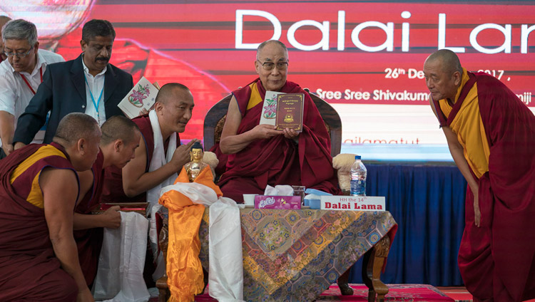 His Holiness the Dalai Lama releasing books produced and published by Sera Jey Monastery before his talk at Tumkur University in Tumakuru, Karnataka, India on December 26, 2017. Photo by Tenzin Choejor