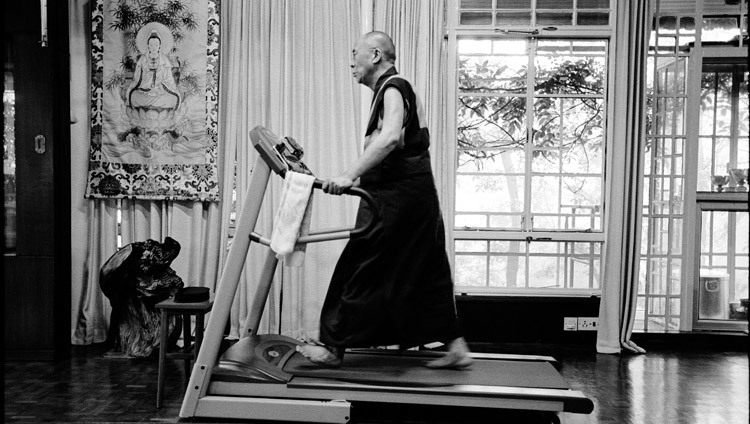 His Holiness the Dalai Lama exercising on his treadmill in his residence in Dharamsala, HP, India on 15 August, 2004. (Photo courtesy of Manuel Bauer)