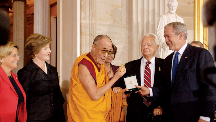 His Holiness the Dalai Lama receiving the US Congressional Gold Medal from US President George W. Bush at Capitol Hill in Washington DC, USA on October 17, 2007.