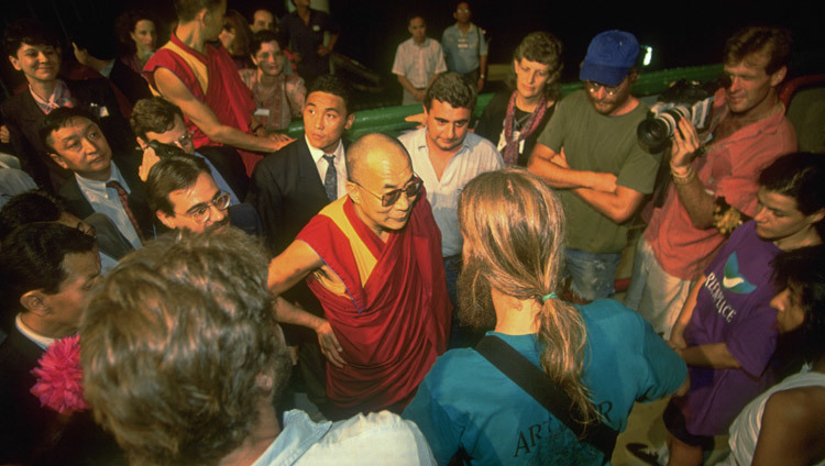 His Holiness the Dalai Lama visiting Greenpeace's Rainbow Warrior during the UNCED Rio Earth Summit in Rio De Janeiro, Brazil on June 1, 1992. (Photo by Green Peace / Steve Morgan)