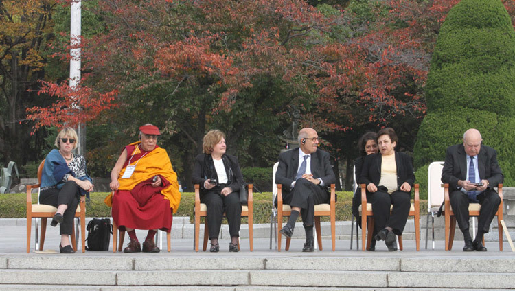 His Holiness the Dalai Lama and fellow Nobel Laureates at the Hiroshima Memorial Park on the third day of the 11th World Summit of Nobel Peace Laureates in Hiroshima, Japan on November 14th, 2010. (Photo by Taikan Usui)
