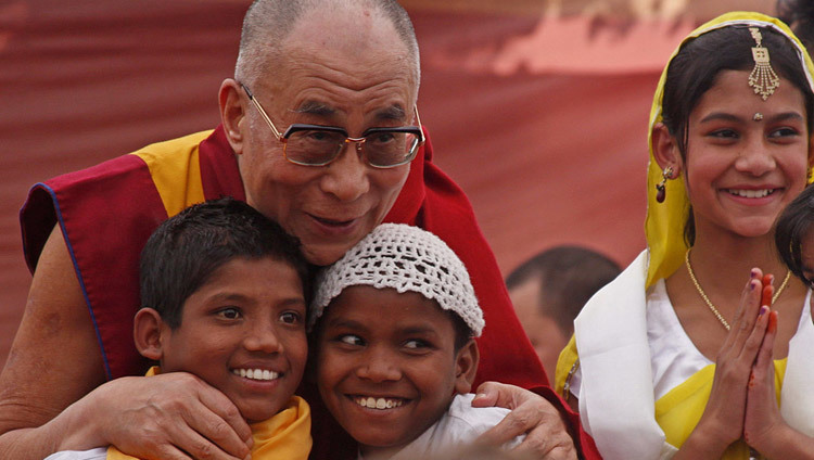 His Holiness the Dalai Lama with young children during the inauguration of the Tong Len hostile in Dharamsala, HP, India on November 19, 2011. (Photo by Tenzin Choejor/OHHDL)